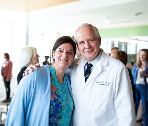 Dr. Keith Aronyk with Patient Mona Mona Nashman Smith