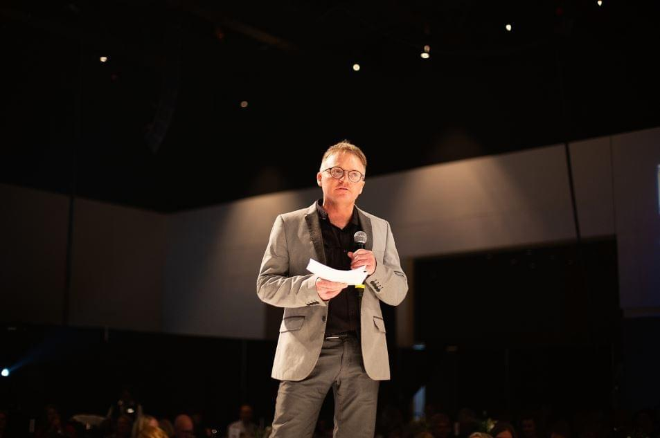 Dr. Robert Stiegelmar speaking at the 2019 Festival of Trees Luncheon & Fashion Show