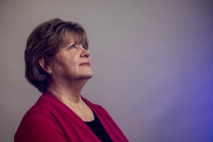 Cathy Housdorff, Gold Leaf Society Member, looking up to the sky thinking of her late father